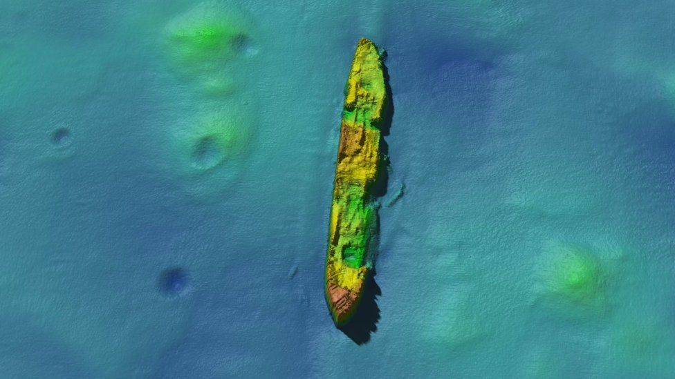 SS Damao lying bow in a north-south position with four craters on the seabed to its left