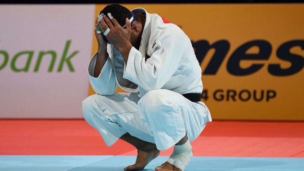 Iranian judoka Saeid Mollaei with his head in his hands