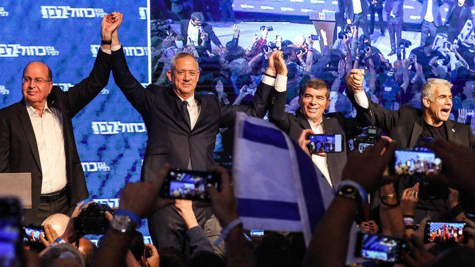 Benny Gantz (2L) celebrates with Moshe Yaalon (L), Gabi Ashkenazi (3L) and Yair Lapid (R) at the Blue and White alliance's headquarters in Tel Aviv on 10 April 2019