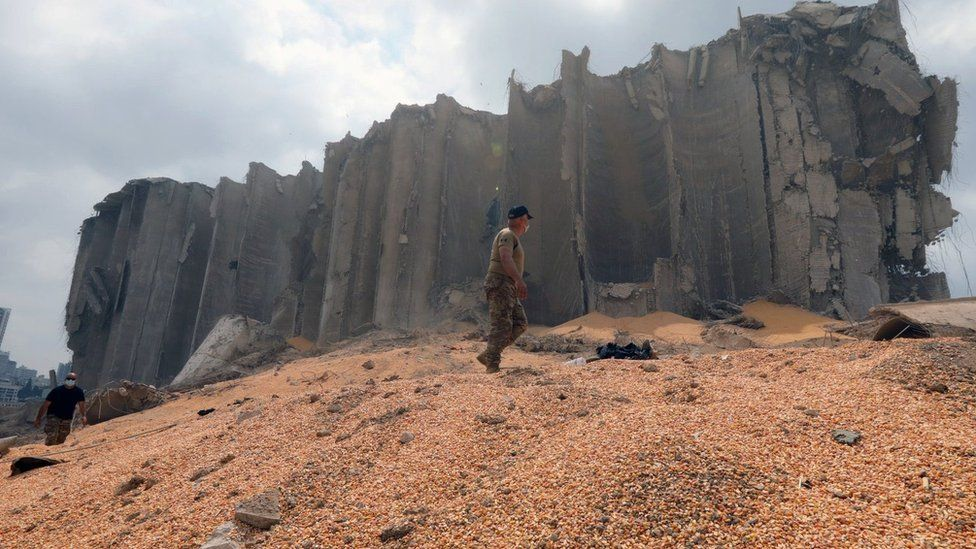 Lebanese army soldier walks on grain next to destroyed silos at Beirut's port (7 August 2020)