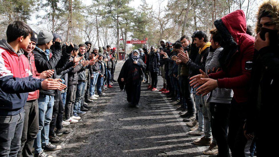 Women Asylum Seekers, waiting at Turkey's Pazarkule border crossing to reach Europe, stage a demonstration at the buffer zone demanding they be permitted to cross during International Women's Day, 8 March 2020