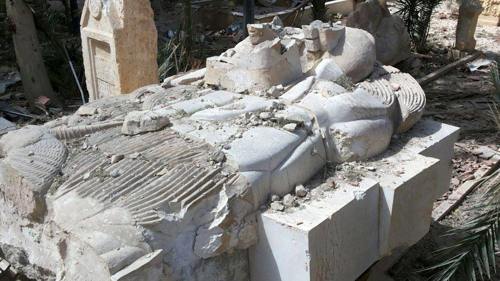 """A view shows a damaged artefact at the entrance of the museum of the historic city of Palmyra, after forces loyal to Syria""""s President Bashar al-Assad recaptured the city"""