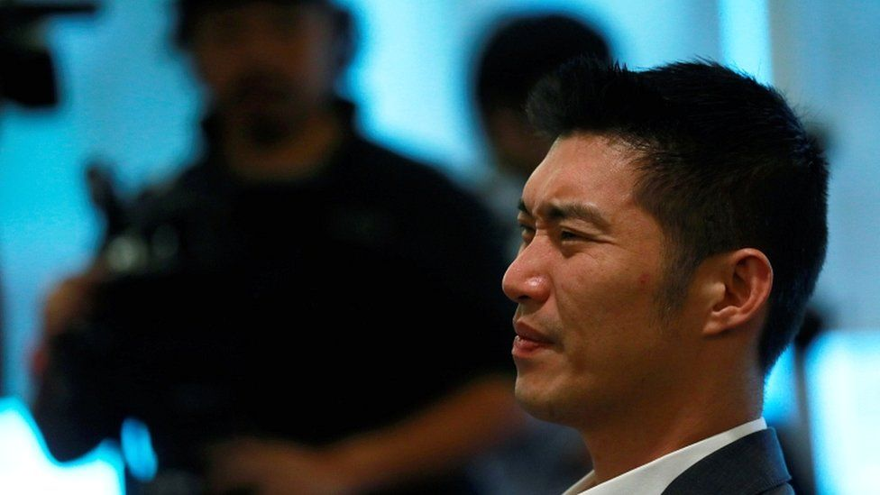Future Forward Party leader Thanathorn Juangroongruangkit reacts as he watches Thailand's constitutional court's ruling at the party's headquarters in Bangkok