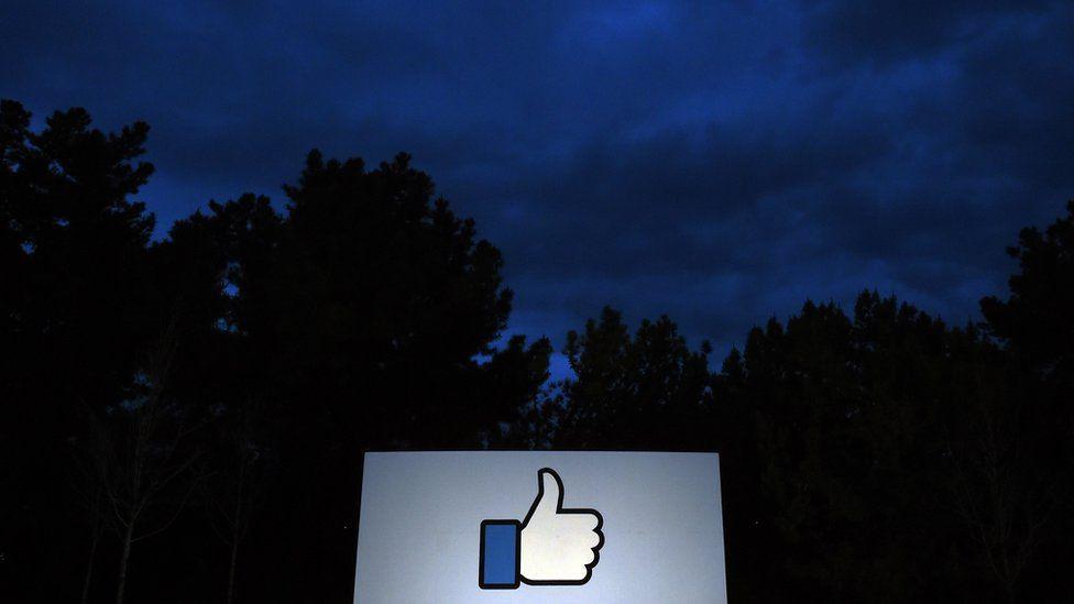 A lit sign at Facebook HQ