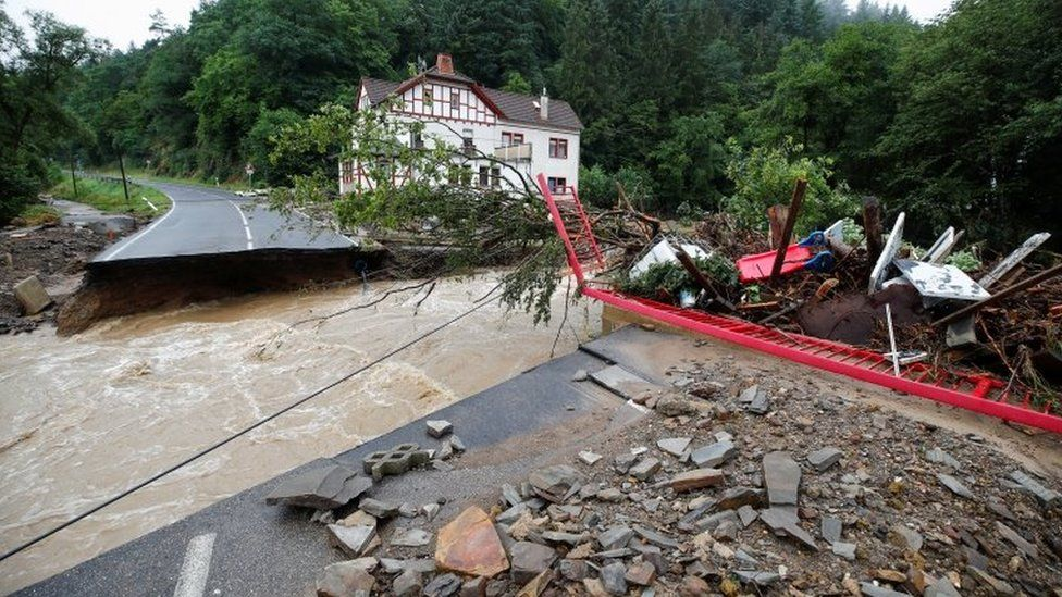 A destroyed road next to the Ahr river is seen on a flood-affected area following heavy rainfalls in Schuld