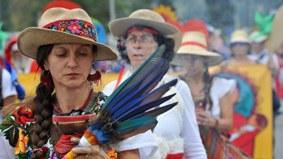 A woman takes part in a ritual during the Global Climate March in Bogota, Colombia, on November 29, 2015