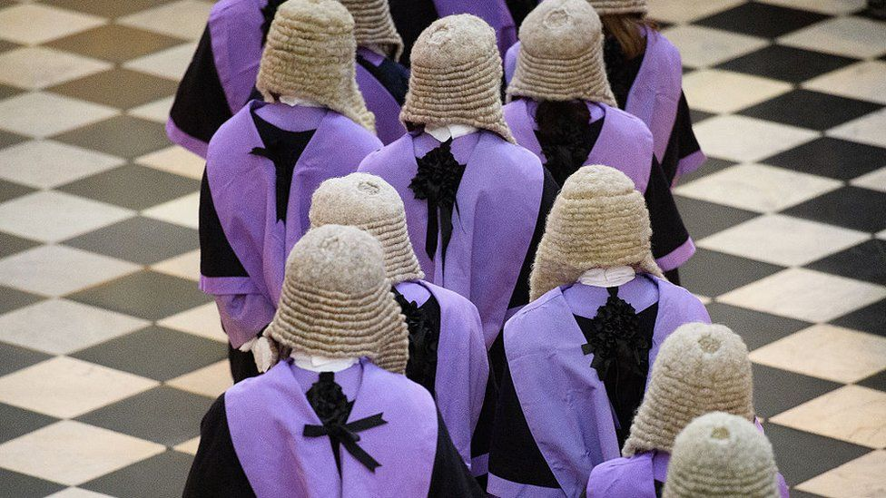 Judges and members of the legal profession take part in a procession inside Westminster