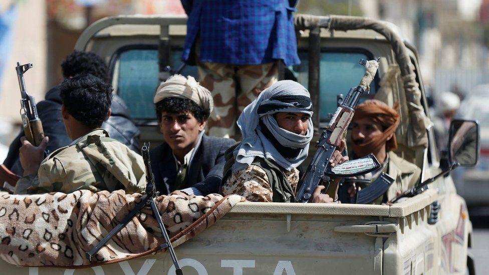 Rebel Houthi fighters sit in a vehicle in Sanaa, Yemen (4 December 2017)