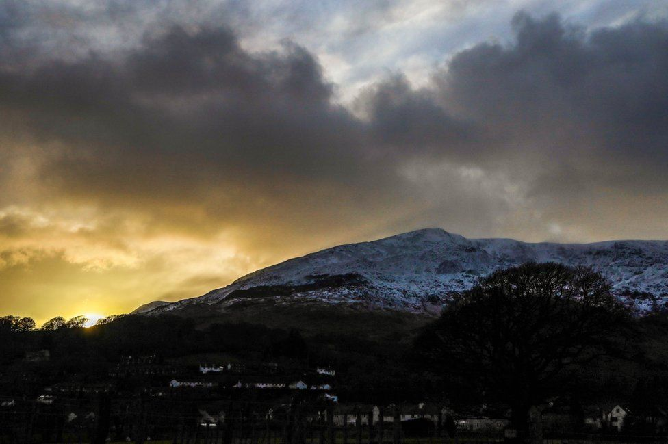 Snow on a hill at sunset