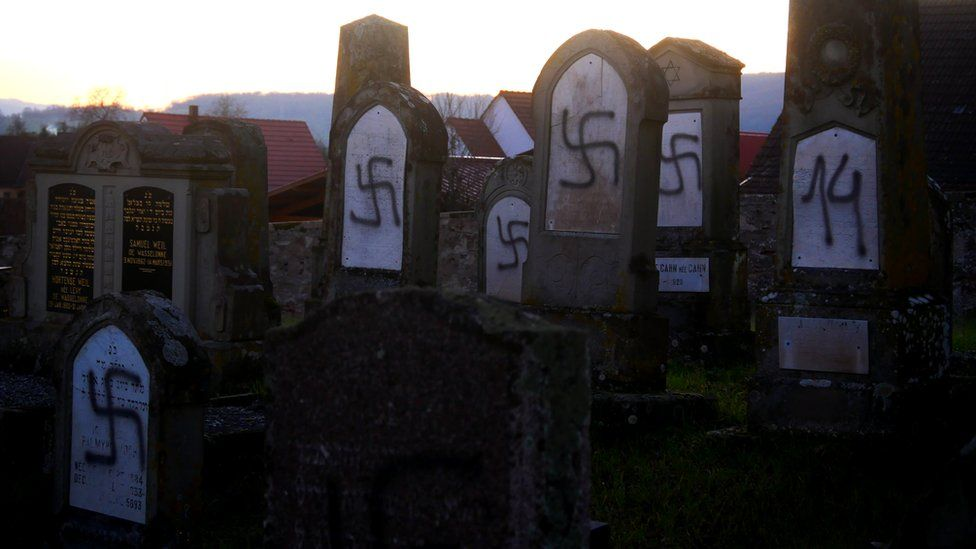 Graves daubed with anti-Semitic symbols and slogans in Westhoffen, France