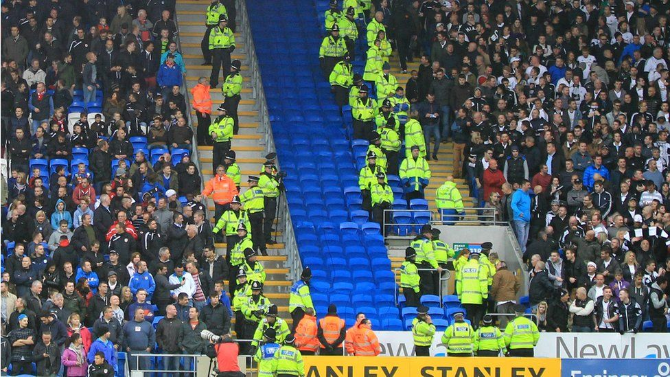 fans kept apart by police
