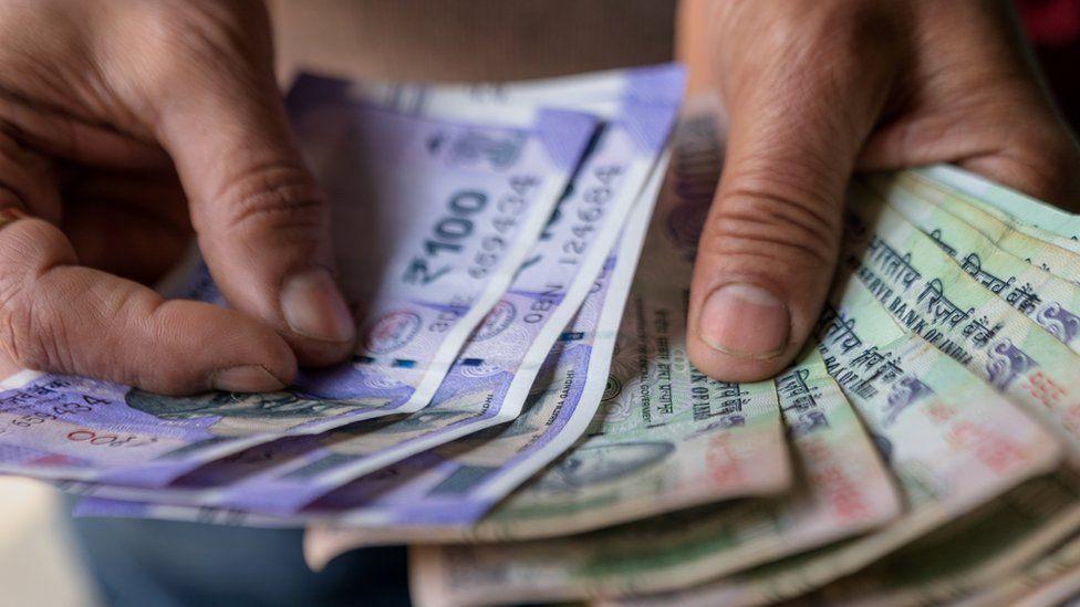 Hand dealing rupees