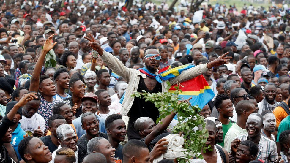 Supporters of Felix Tshisekedi, leader of the Congolese main opposition party, the Union for Democracy and Social Progress (UDPS) who was announced as the winner of the presidential elections, celebrate outside the party's headquarters in Kinshasa
