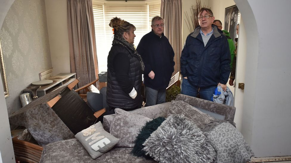 First Minister Mark Drakeford visits a flood-affected house in Nantgarw
