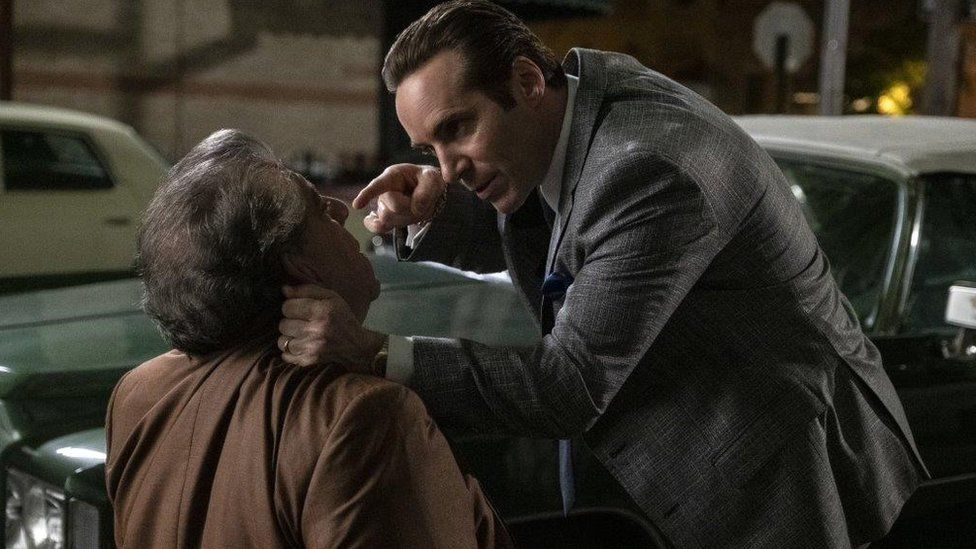 Alessandro Nivola with another actor in The Many Saints of Newark: