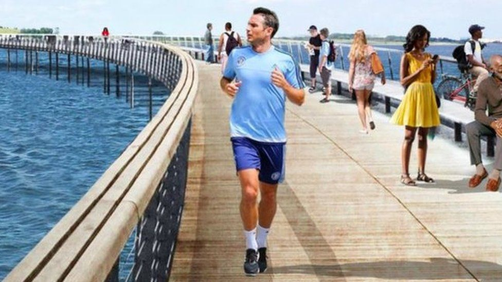 A CGI image of a bridge in a park. Some people have been edited into the image, among them is Frank Lampard.