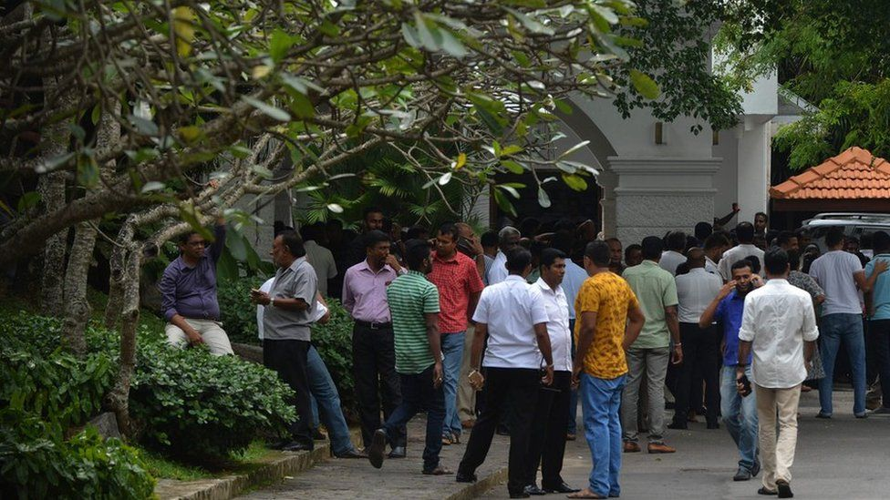 Supporters have gathered outside Mr Wickramasinghe's residence