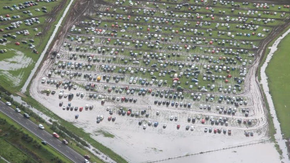 Flooded park and ride site for Festival No.6 in Porthmadog