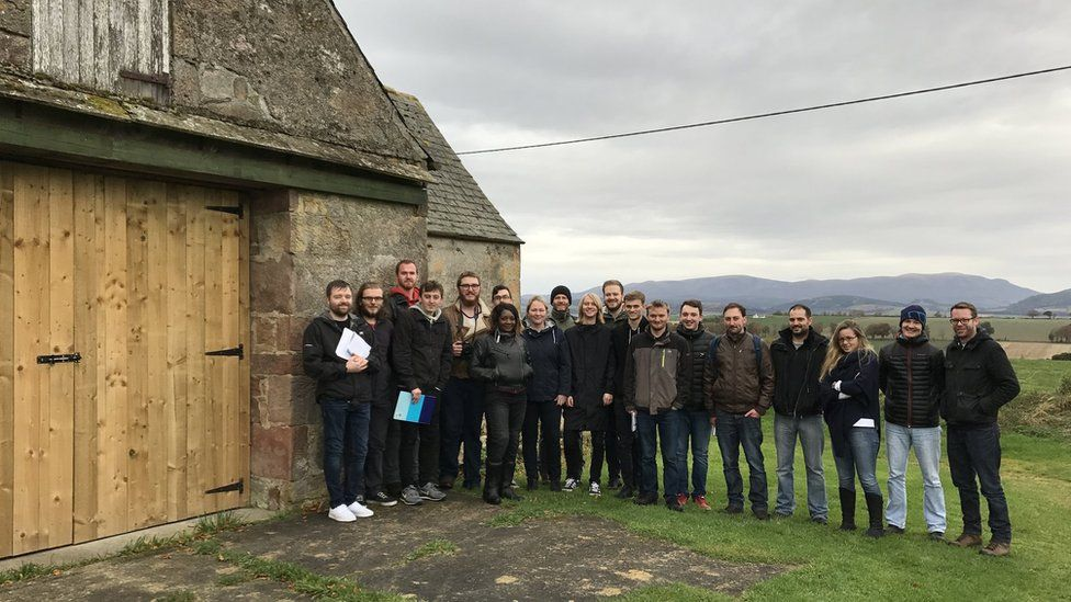 Students at site of mill