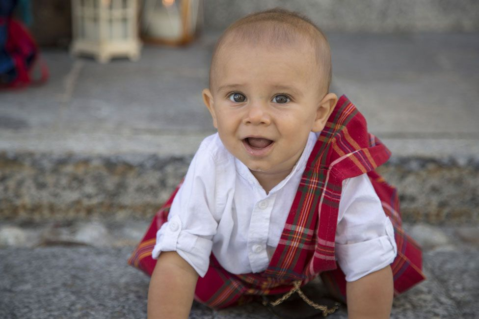 A baby wearing tartan in Gurro