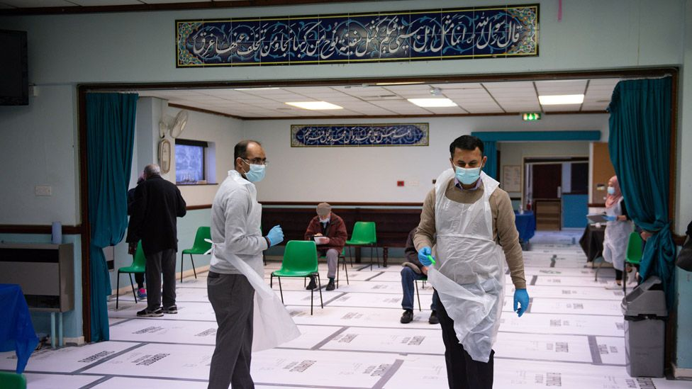 Pharmacists at the Al Abbas Mosque, Birmingham, which is being used as a Covid vaccination centre