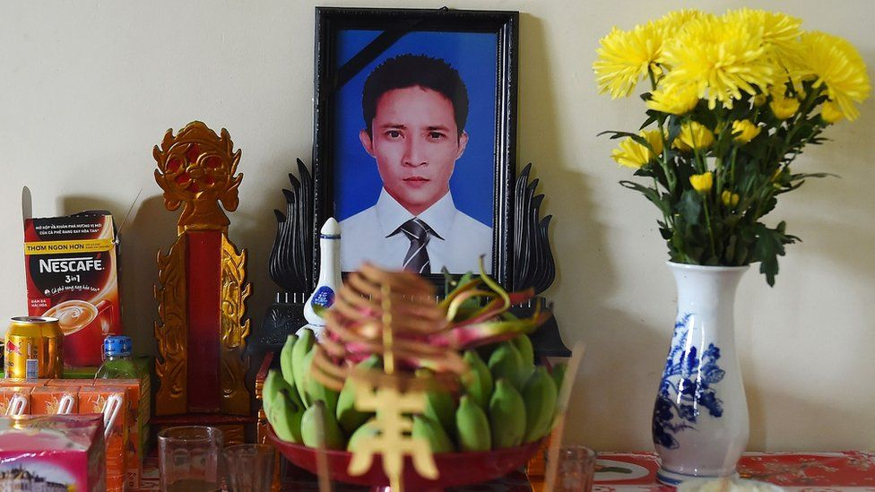 A portrait of Le Van Ha on a prayer altar at his house in Vietnam's Nghe An province