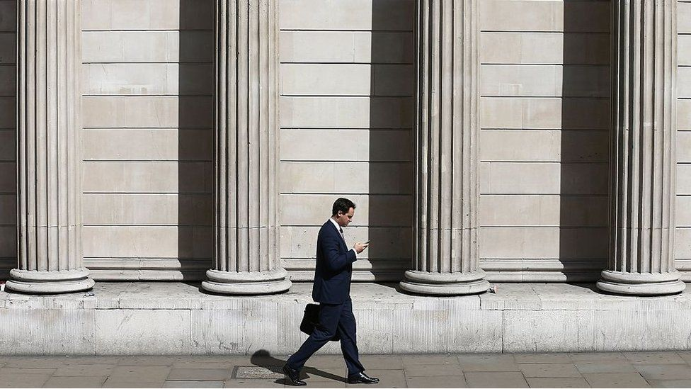A man walks past the the Bank of England