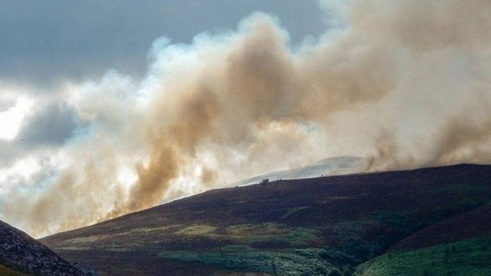 A photo of the Llantysilio mountain fire with a large plume of smoke