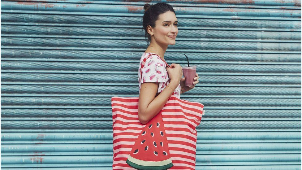 A model carrying a Cath Kidston bag