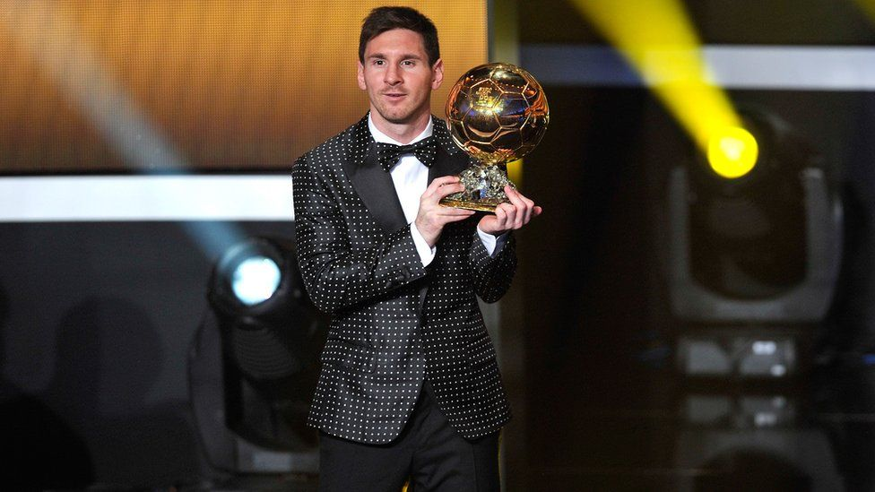 Lionel Messi in a matching polka dot DJ and bow tie