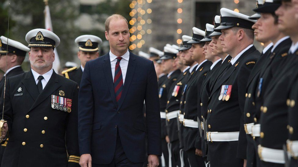 Prince inspects the honour guard at the Legislative Assembly in Victoria