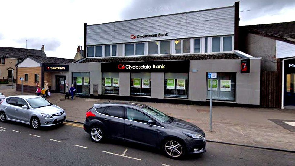 Security staff were assaulted outside the bank in Main street on Friday morning