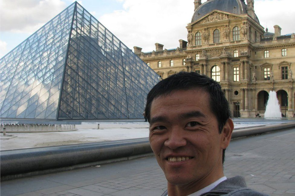 Ricardo Shimosakai outside the Louvre in Paris