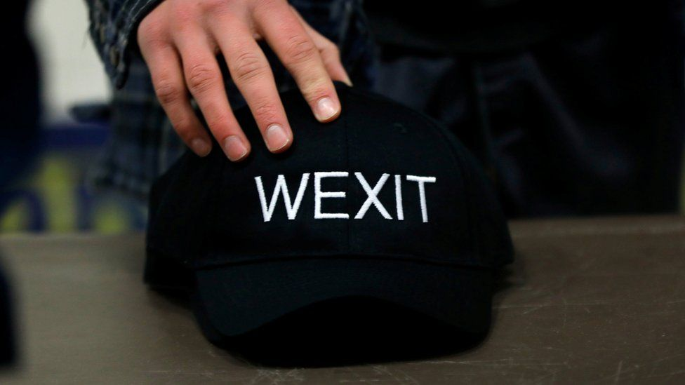 A supporter holds his Wexit hat at a rally for Wexit Alberta, a separatist group Alberta independence