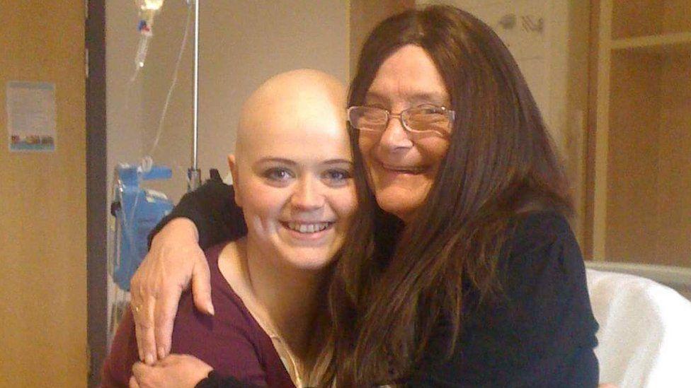 Eimi hugging her grandma on a hospital bed