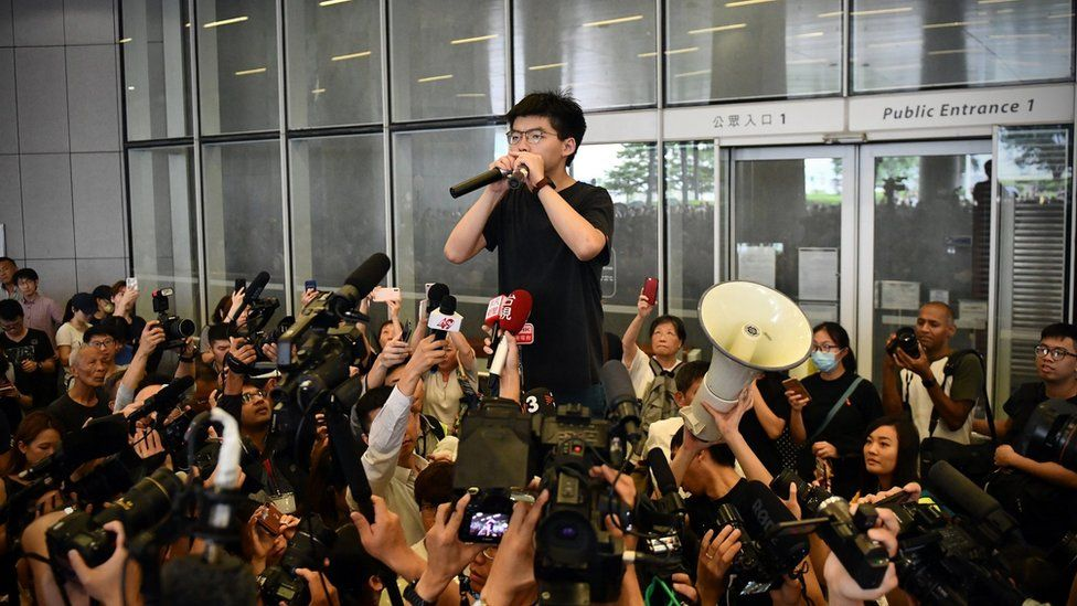 Joshua Wong speaks to the media and supporters outside the Legislative Council in Hong Kong, shortly after being released from prison on June 17th 2019