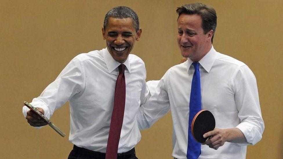 David Cameron playing ping pong with President Obama
