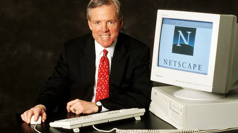 James Barksdale with a computer showing the Netscape logo