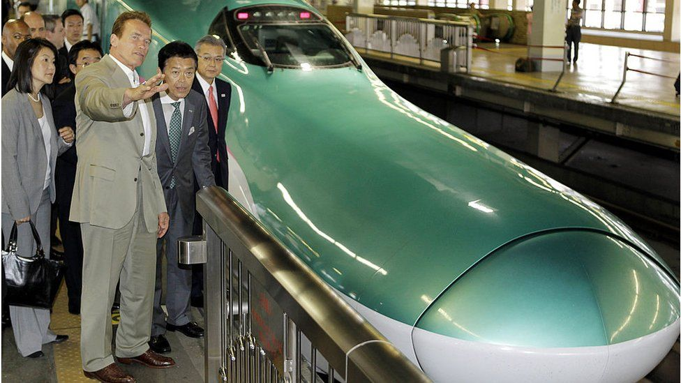 Then-California Governor Arnold Schwarzenegger inspects bullet trains in Japan in 2010 as inspiration for California's own train updates