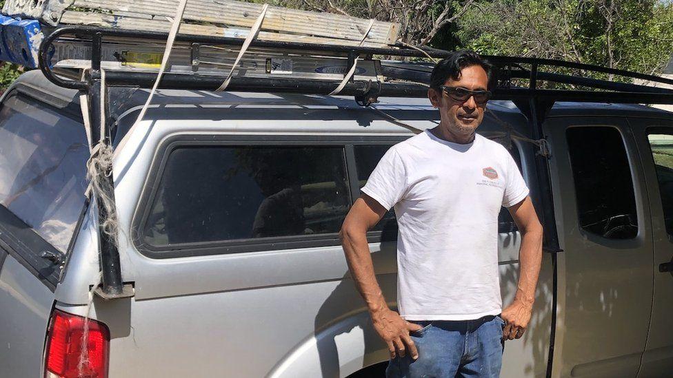 Cesar David Gonzalez in front of his truck
