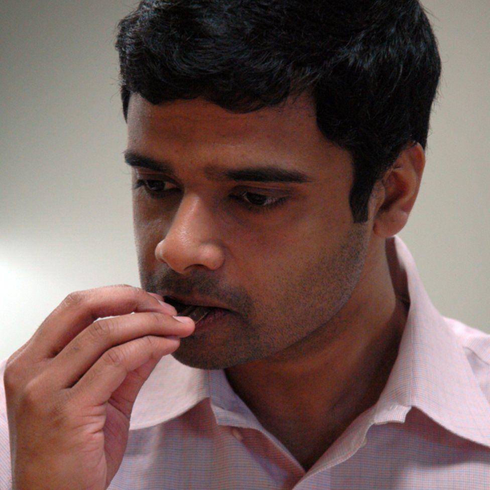 Sidhartha Nilakanta tastes a piece of chocolate