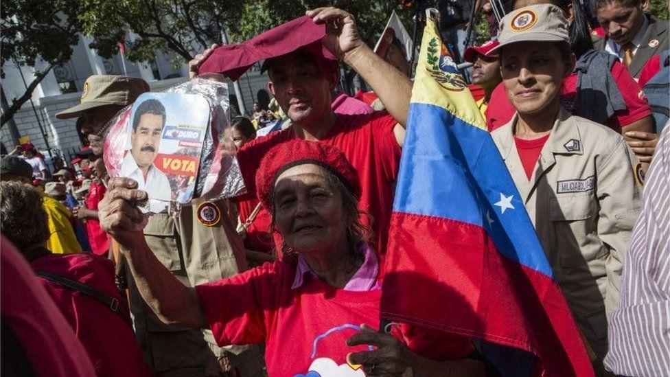 "People participate in an ""anti-imperialist"" march in Caracas, Venezuela, 14 August 2017."