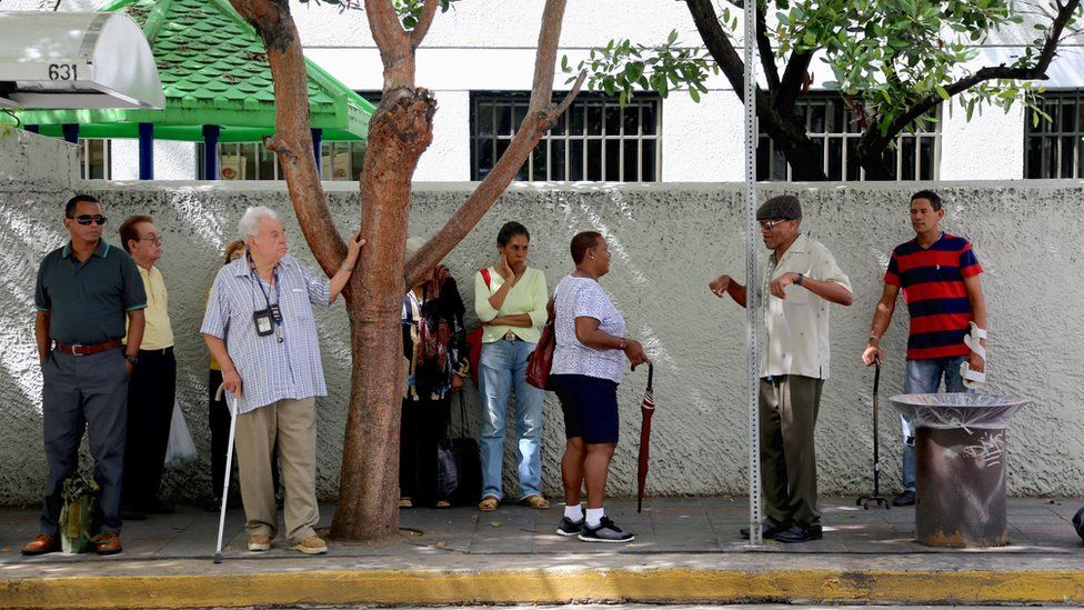People at a bus stop in San Juan Puerto Rico