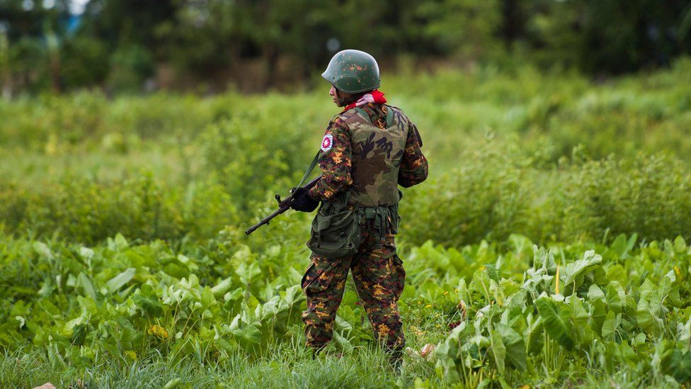 A Myanmar soldier stands on guard in Rakhine state in 2018