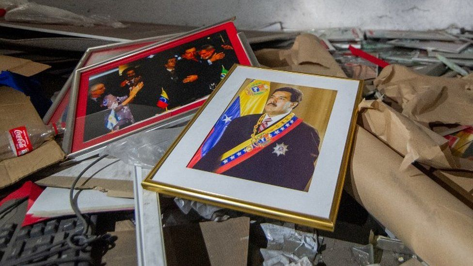 A framed picture of Nicolas Maduro remains at the Venezuelan consulate in Bogota, Colombia as it sits in ruins after being looted for months, on July 29, 2020, in Bogota, Colombia.