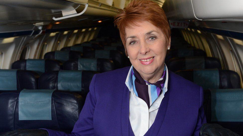 Charmaine McCall-Hagan onboard an aircraft