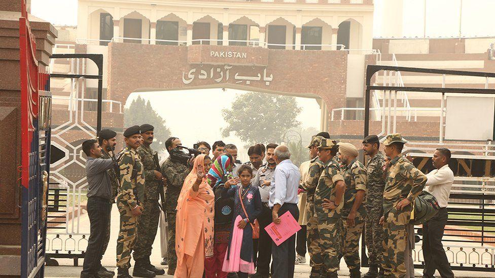 Fatima, Mumtaz and Hina wave as they enter Pakistan through the Wagah border