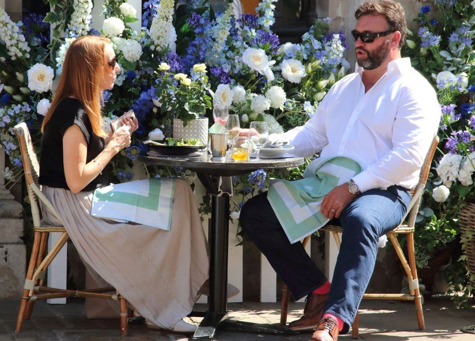 A couple in Yorkshire enjoy a meal outside during the Eat Out to Help Out scheme