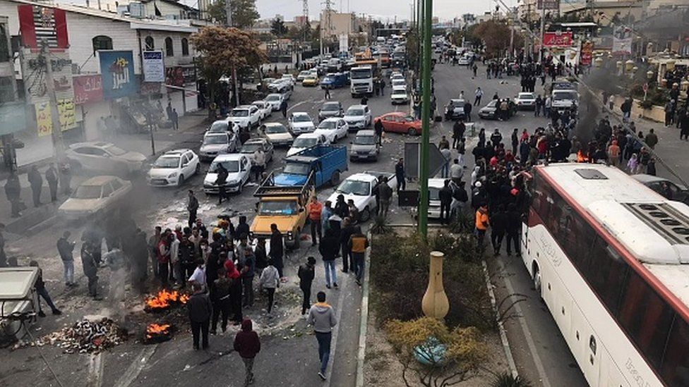 Protesters start fires as they block the roads during a protest against gasoline price hike at Damavand of Tehran, Iran, in November 2019