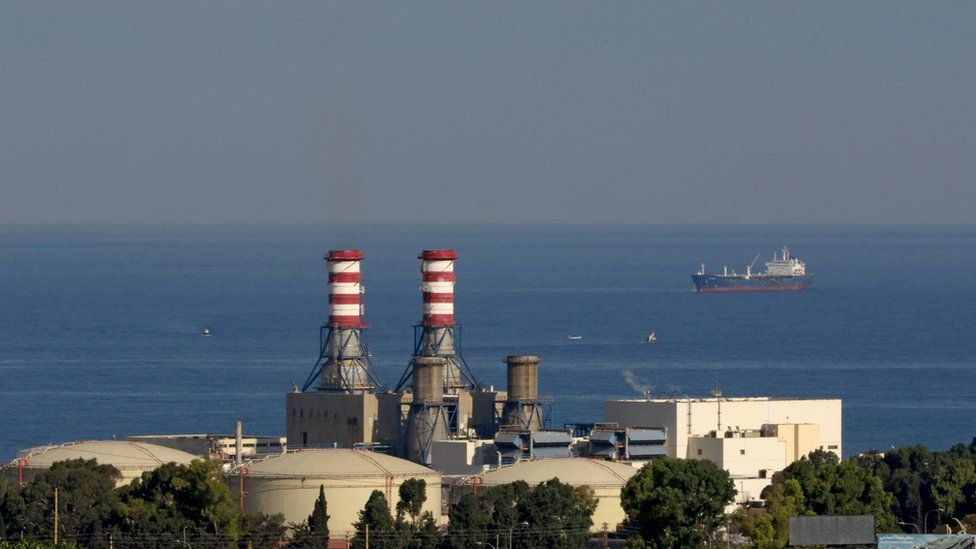 An oil tanker carrying fuel oil from Iraq, is seen anchored near the Zahrani power plant in Zahrani near the southern Lebanese city of Sidon (Saida) on September 18, 2021. -